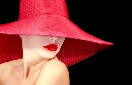 face of a beautiful woman in hat with red lips