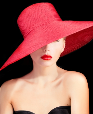 portrait of a beutiful lady in red hat with red lips