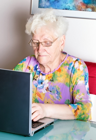 old woman using computer . photo
