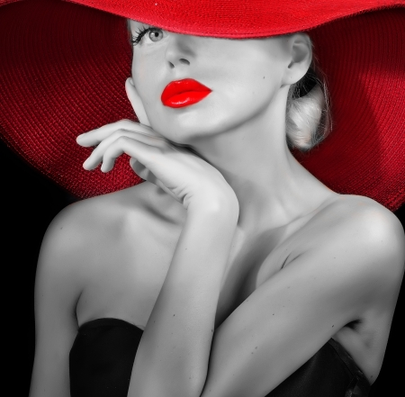 classy lady in red hat black and white portrait photo