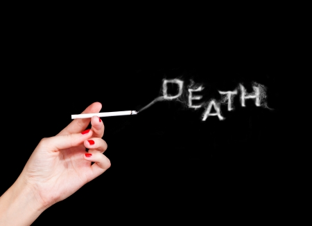bad girl: woman holding cigarette with word death from smoke abstract image Stock Photo