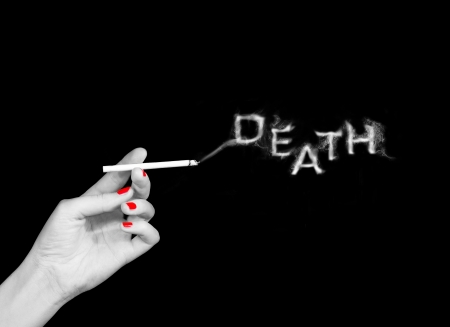 woman holding cigarette with word death from smoke abstract image photo