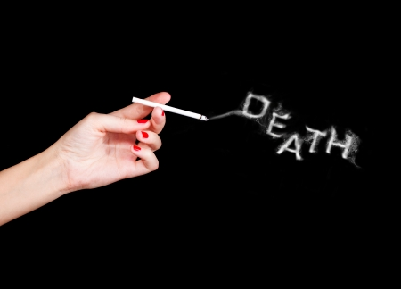 woman holding cigarette with word death from smoke Stock Photo - 22937053