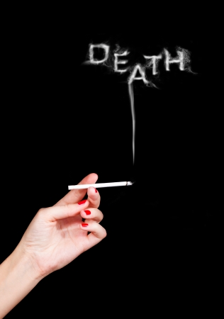 cigarette in woman's hand with word death from its smoke Stock Photo - 22937064