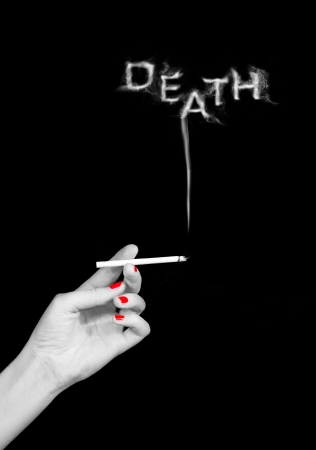 cigarette in womans hand with word death from its smoke photo