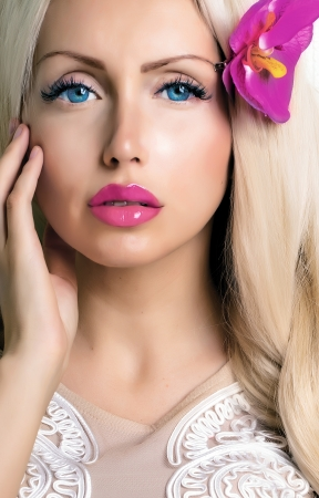 young beautiful woman with flower in hair and bright lipstick photo