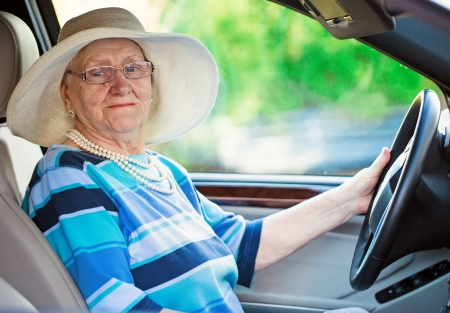 active mature woman in a car Stock Photo