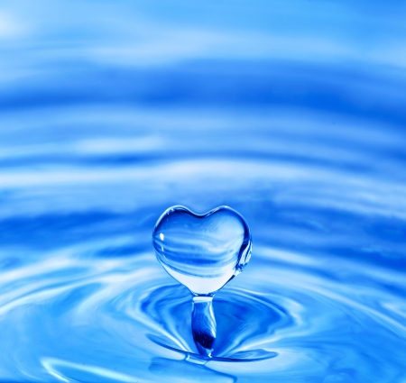 water drop in shape of heart photo