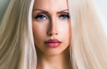 hait: beautiful girl with long hait looking at camera close up picture
