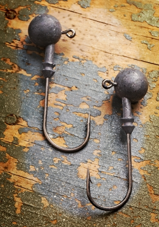 two fishhooks on shabby aged blackboard close up picture photo