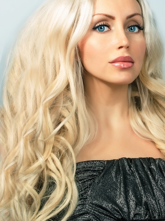 cute young blond woman with long curly hair