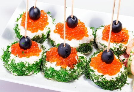 healthy snack from red caviar olive and french bread with dill photo