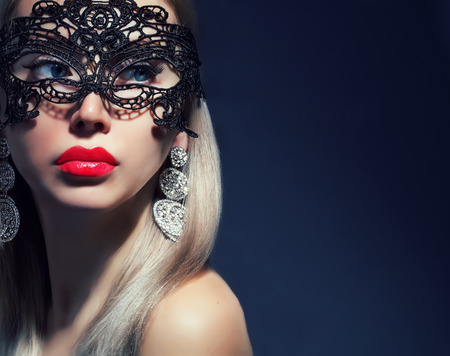 beautiful woman in mask with red lips Stock Photo