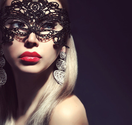fashionable woman in mask with red lips Stock Photo
