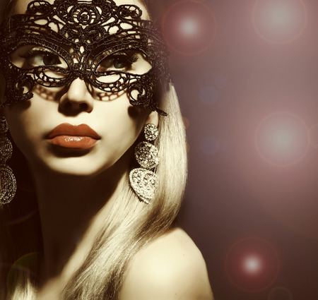 beautiful woman in mask with red lips photo
