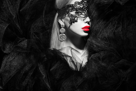 black mask: beautiful lady in mask with red lips black and white portrait Stock Photo