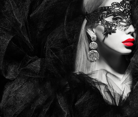 portrait of a woman in mask black and white photo