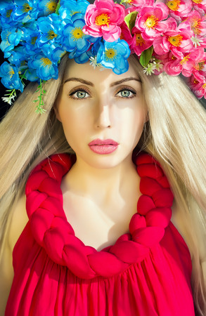 beautiful model with  cloroful flower wreath photo