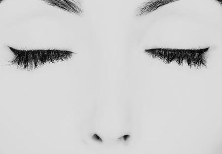 closed eyes with long eyelashes photo