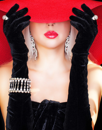 mysterious woman in red hat . Stock Photo