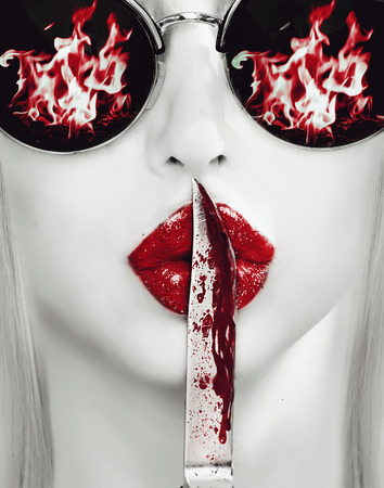 hot sexy girl: knife on lips. revenge abstract picture Stock Photo