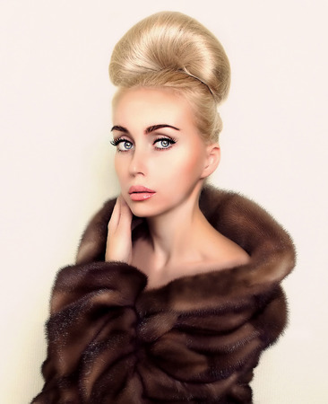 updo: fashion model in brown mink fur coat with classic bun updo