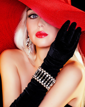 beautiful blue eyed blonde girl in a hat photo