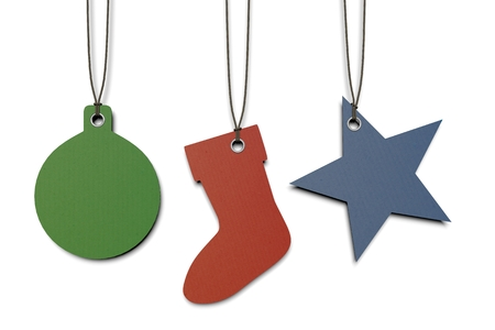 christmas sock: colored paper tags shaped in Christmas theme: glitterball, sock, star Stock Photo