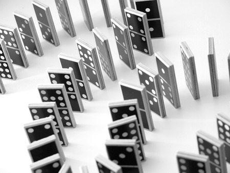 dominoes lined up in curves Stock Photo