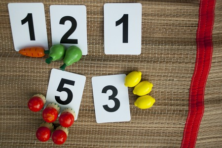 Early math with basic childish numbers wooden toy fruits