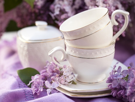 porcelain flower: porcelain cup with coffee and lilac