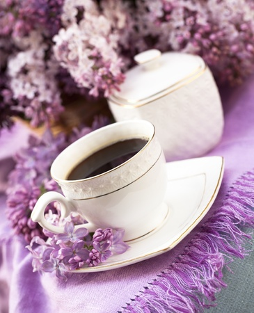 porcelain: porcelain cup with coffee and lilac