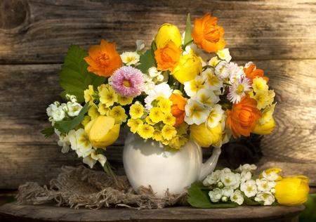 camomiles macro: bouquet of flowers Globeflowers Orange