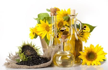 zonnebloem: zonnebloem-en plantaardige oliën, zaden, ecologische stilleven Stockfoto