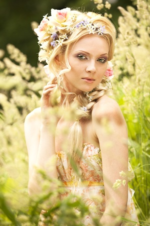 Young girl blonde and flowers in her hair  Stock Photo - 10307139