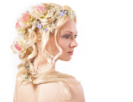 Young girl blonde and flowers in her hair  photo