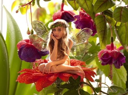 The little elf on a flower in a fairy garden  photo