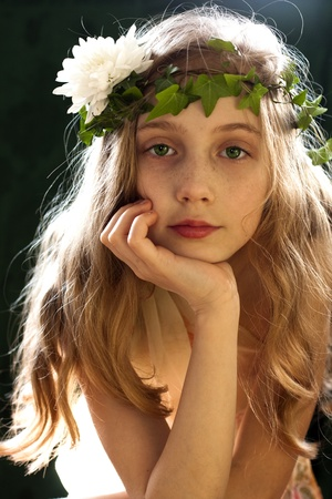 portrait of a girl wearing a crown of ivy photo
