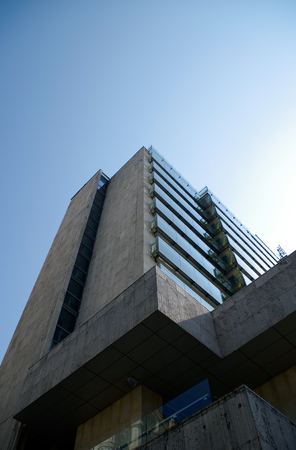 building feature: Low angle view of skyscraper against sky. Stock Photo