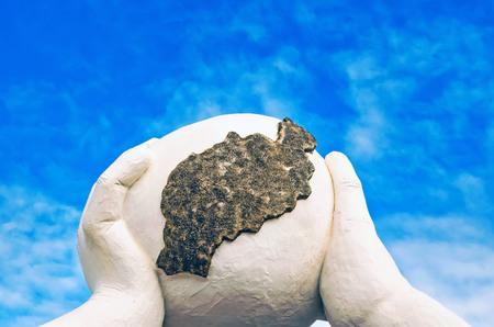 Close-up of hand holding rock against blue sky. Photo taken in Tias, Las Palmas, Spain.