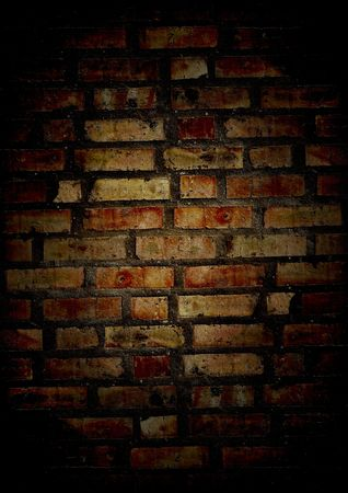 grunge cracked old brick wall in night photo