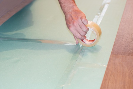 substrate: laminate on substrate and hand with Scotch
