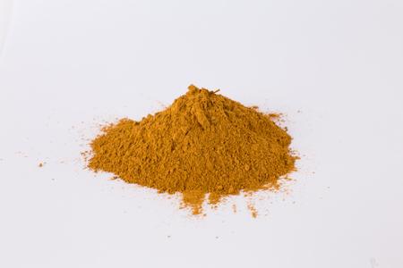 ocher orange pigment on a white background