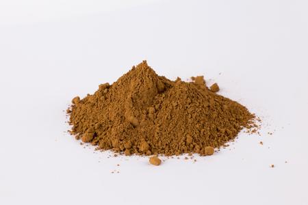 dark ocher pigment on a white background Stock Photo