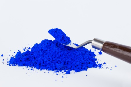 pigment on a white background, blue pigment in a bottle Stock Photo
