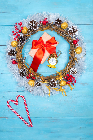 Christmas beautiful wreath on a wooden table with copy space Foto de archivo