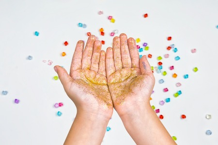 childrens hands on a white background, hands holding beads on a white background