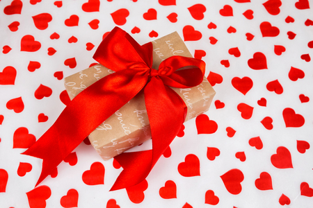 Valentines Day. Presented as a red ribbon on a white paper with red hearts