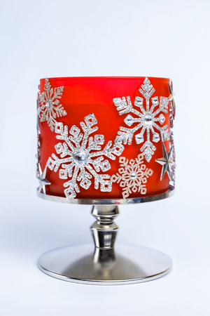 beautiful decorated snowflakes candlestick on a white background. Stock Photo