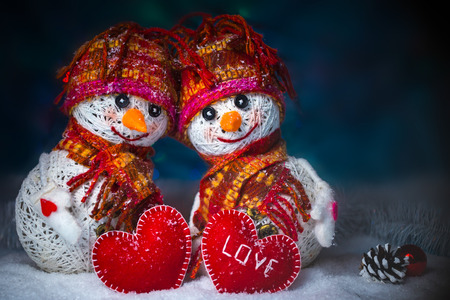 Love snowmen. Snowfall. Love concept. Greeting card Happy Valentines day